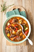 Fiery goulash soup with peppers and mushrooms