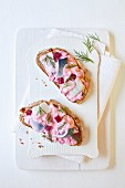 Herring salad with beetroot and dill on bread