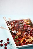 Oven-cooked lamb shank with cherries