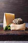 Cheese and fruit on wooden cutting board
