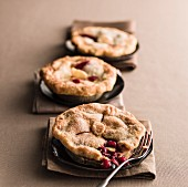 Miniature cherry pies with fork