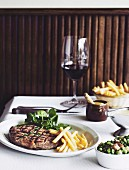 Steak Frites with sauce bearnaise and peas