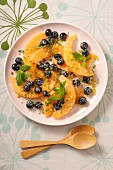 A melon salad with blueberries and mint