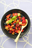 Fruit salad with berries, melon and basil