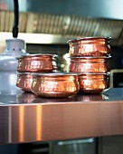 Copper pots in a restaurant kitchen