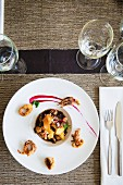 Seafood dish garnished with fried calamari
