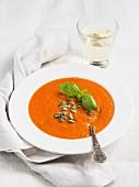 Tomato cream soup on white background