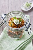 Baked aubergines with tzatziki in a glass jar