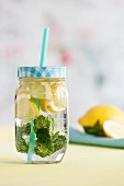 Lemonade with mint in a glass jar