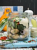Potato salad with broccoli and vegan mayo in a glass jar