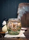 Buckwheat and spinach salad with mushrooms and vegan mayo in a glass jar