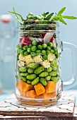 Sweet potato beans and peas with radishes and pumpkin seeds in a jar