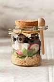 Greek style lunch jar with feta cheese and black olives in a cute jar with cork lid and wooden spoon