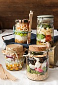 Selection of lunch jars with a different selection of fillings in each