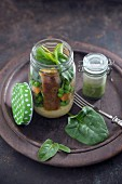 Mashed potatoes, mixed vegetables, vegetable fingers, spinach and a broccoli cream sauce in glass jars