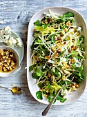 Apple, celery and Roquefort salad with roasted hazelnut-raisins