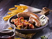 Curry sausages with fries and onion rings
