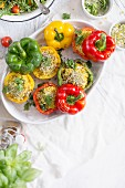 Rice And Pumpkin Stuffed Peppers baked in a white dish