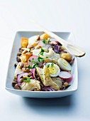 Cod salad with hard boiled eggs, radishes and black-eyed peas