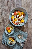 Fruit salad with apple, mango, grape, banana and pear