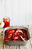 Plum compote with a glass jar