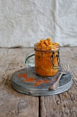 Sauerkraut with peppers in a glass jar