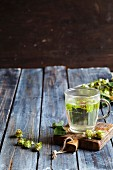 Hops tea in a glass cup on a chopping board