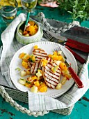 Grilled pork cutlet with a pineapple, orange and pepper salsa