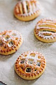 Cookies with jam and powdered sugar on parchment