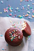 Macaroons in chocolate glaze with candy sprinkles