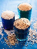 Different varieties of rice in blue glass jars