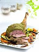 Roast lamb with a herb crust and grilled vegetables