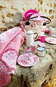 Picnic arranged on stone with vintage-style pink accessories