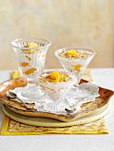 Breakfast Sundaes: yogurt with muesli and apricots in glass dishes