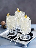 Champagne jelly with gold leaf in dessert glasses