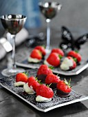 Strawberries dipped in white and dark chocolate