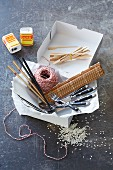 Kitchen utensils: wooden skewers, chopsticks, cutlery, kitchen string, bamboo mat