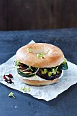 A bagel filled with grilled courgettes and aubergines