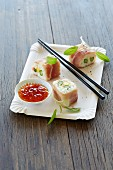 Sushi with serano ham, green asparagus and sweet and sour sauce