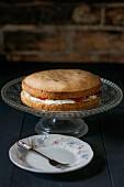 A Victoria sponge cake on a cake stand
