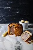 Sliced pork pie on a marble plate