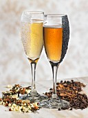 Two champagne glasses with sugar and chocolate chips