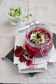 Beetroot cream soup in a glass jar