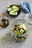Israeli couscous with zucchini and halloumi in a glass jar