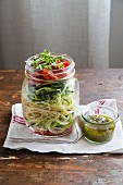 Spaghetti with marinated zucchini and pesto