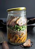 Roasted duck breast with buckwheat, grilled sweet potatoes and green beans in a glass jar