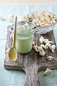 Soup in a glass with popcorn