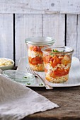 Bulgur wheat with Letscho (peppers in tomato sauce) in glass jars