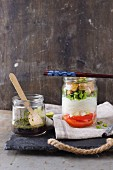 A glass noodle salad with peppers and tofu in a glass jar