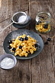 Kaiserschmarren (shredded pancakes) with blueberries and icing sugar